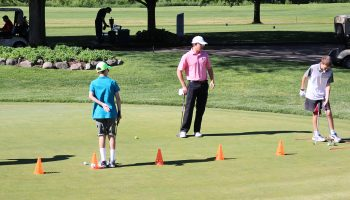 Youths learning golf skills